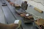 В Кировском районе гастарбайтеры вручную пекли «заводские» сласти: Фоторепортаж