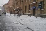 Фоторепортаж: «На улице Савушкина льдом вдребезги разбили остановку»