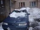 Разбитые глыбами льда автомобили: кто виноват?: Фоторепортаж
