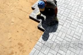 Москвичи провели акцию против замены асфальта на тротуарную плитку