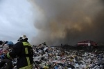 Фоторепортаж: «Пожар на свалке потушили только через два дня»