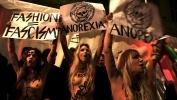 Фоторепортаж: «Девушки из движения FEMEN оголили груди на участке, где голосовал Путин»