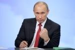 Фоторепортаж: «Владимир Путин набирает более 64 процентов»