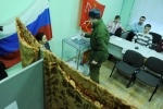 Фоторепортаж: «В Петербурге за Путина проголосовали 53% избирателей»