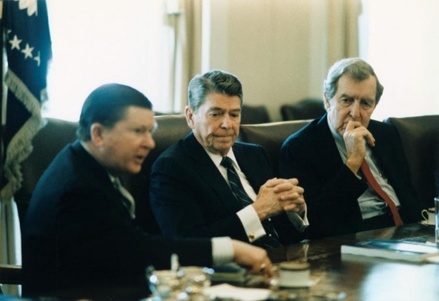 President_Ronald_Reagan_receives_the_Tower_Commission_Report_with_John_Tower_and_Edmund_Muskie.jpg