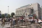 Пожар в общественной приемной Единой России в Новосибирске: Фоторепортаж