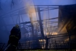 Фоторепортаж: «Пожар на Кондратьевском рынке»