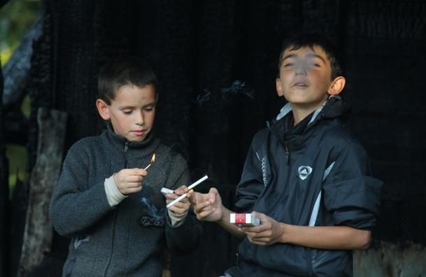 Курящих школьников