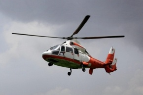 Жители Ленобласти просят наказать хозяина вертолета, приземлившегося на кладбище