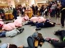 Активисты «Хрюши против» «умерли»  в «Стокманне» : Фоторепортаж