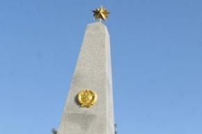 Могилы советских воинов в Литве раскрасили в цвета флага Украины