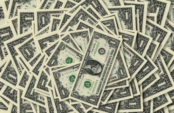 Курс доллара снизился до 52,54 рублей