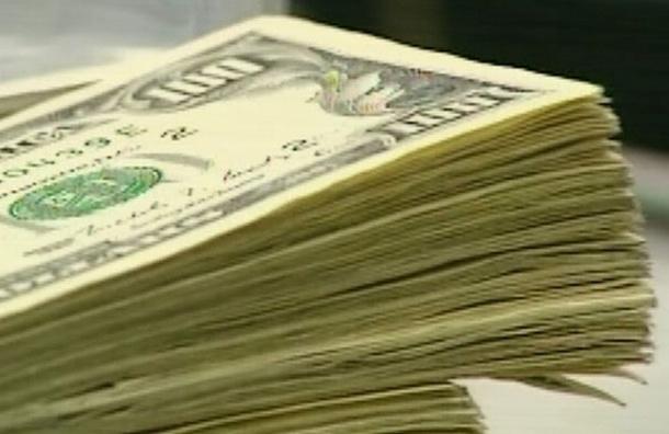 Курс рубля укрепился по отношению к доллару и евро