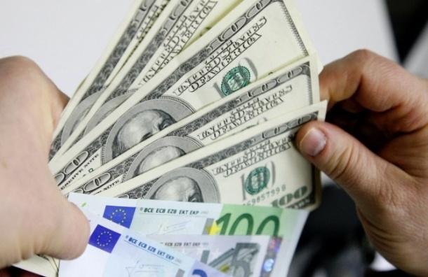 Курс доллара с начала торгов на Бирже опустился ниже 57 рублей