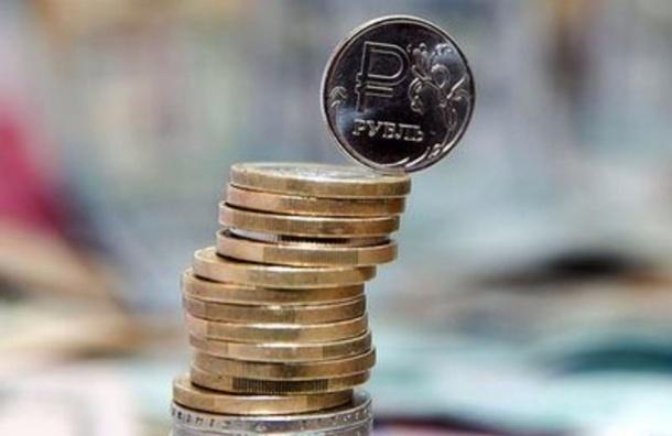 Рубль вырос по отношению к доллару и евро