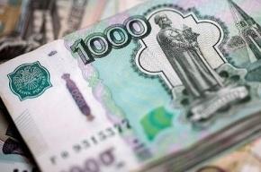 Рубль падает в цене вслед за нефтью