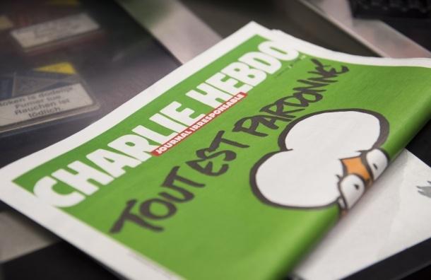 Новую карикатуру на теракты в Брюсселе опубликовал Charlie Hebdo