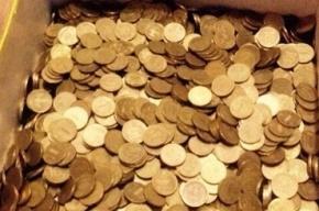 Бизнесмен из Томска выдал долг по заплате тремя килограммами монет