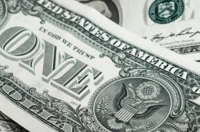Доллар и евро упал на бирже ниже психологических отметок