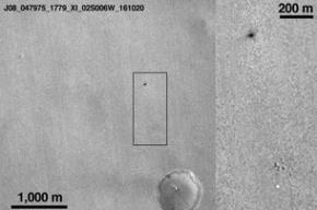 Зонд Schiaparelli оставил на поверхности Марса темное место