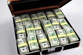 Мигранта с фальшивыми долларами поймали в банке на Сенной площади