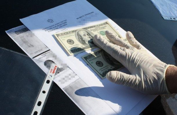 Двое полицейских попались навзятке в50 тысяч рублей